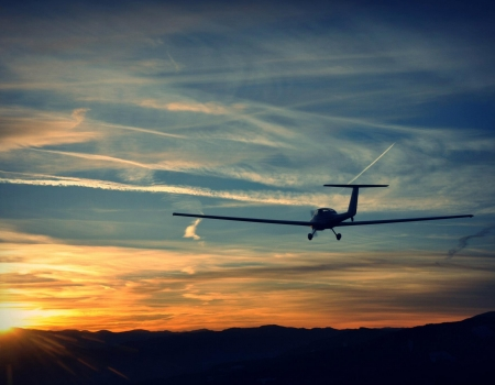 Grob 109B Aircraft in flight during sunset