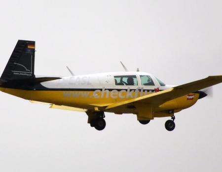 Mooney M20K in flight